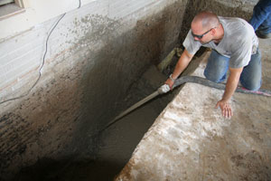 Foundation Specialist injecting cellular concrete in St. Charles